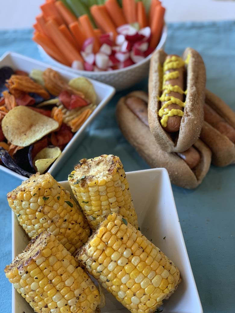 BBQ foods, grilled corn on the cob and hot dogs