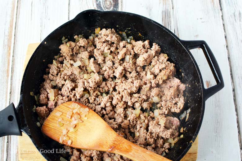 ground turkey and onions in cast iron pan