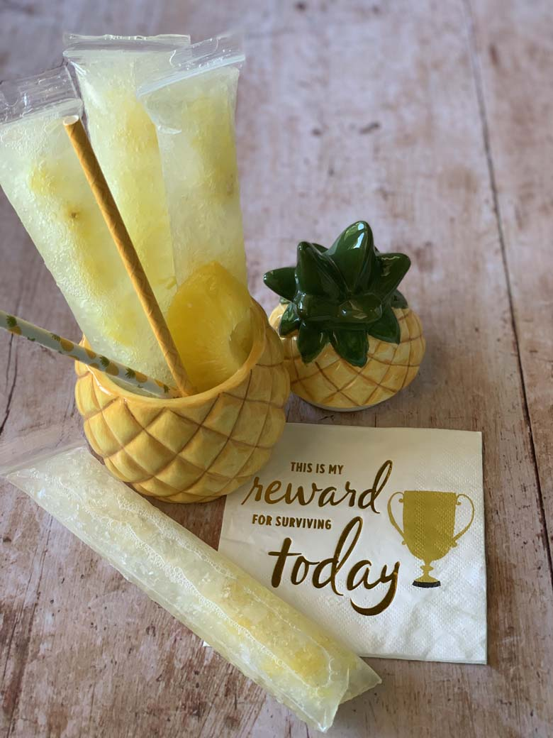 pineapple vodka pops in a pineapple cup with a napkin