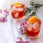 This Ginger Cranberry Mule is the perfect Happy Hour cocktail. Cranberry Vodka, Ginger Beer, Orange Juice, and a splash of Angostura Orange Bitters makes this Mule refreshing and delicious!