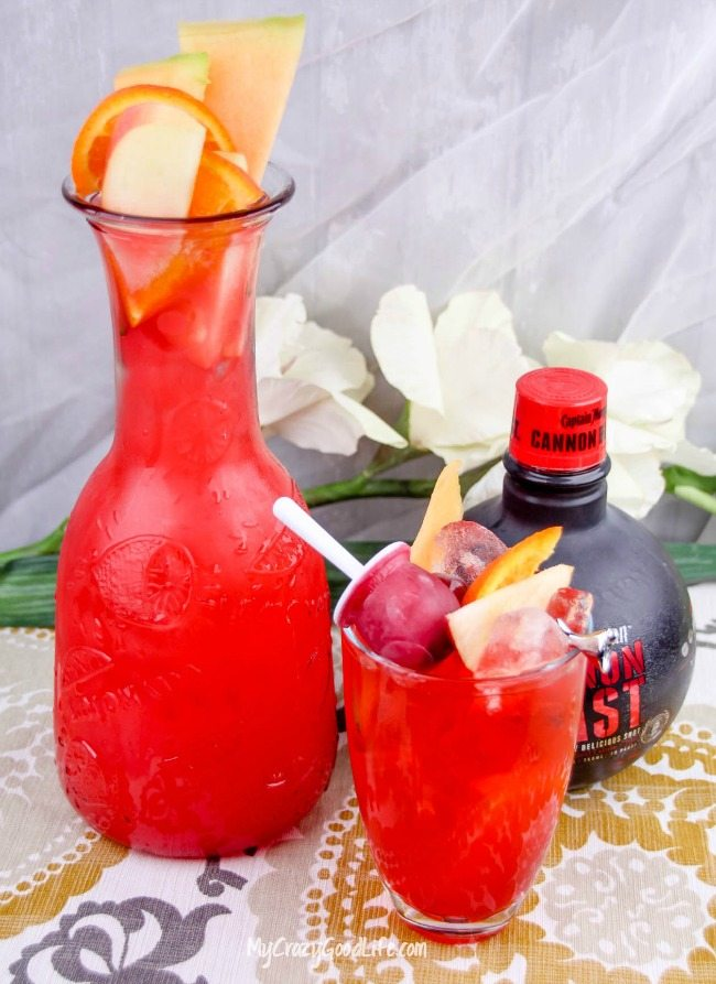 This delicious and refreshing Strawberry Margarita Punch includes a fun and sweet fruit popsicle. It's perfect for cooling off and takes you back to the days when it was fun to dip your popsicle in your juice–you used to do that too, right?