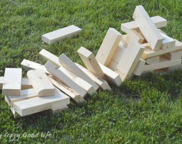 You can easily build this backyard game DIY Giant Jenga for your next party or picnic. There are only a few supplies needed, and it's a great family game!