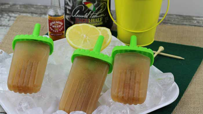 Popsicles are not just for the kids anymore! These Boozy Arnold Palmer Pops are going to be your new favorite adult treat!