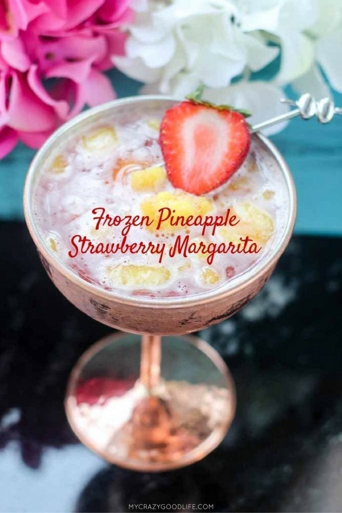 It can be summer everyday with this delicious frozen margarita recipe–it's a Frozen Pineapple Strawberry Margarita. Cool off or chill out with this tasty summer margarita recipe!