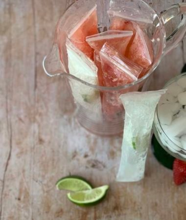 top down image of strawberry margarita popsicles in a pitcher
