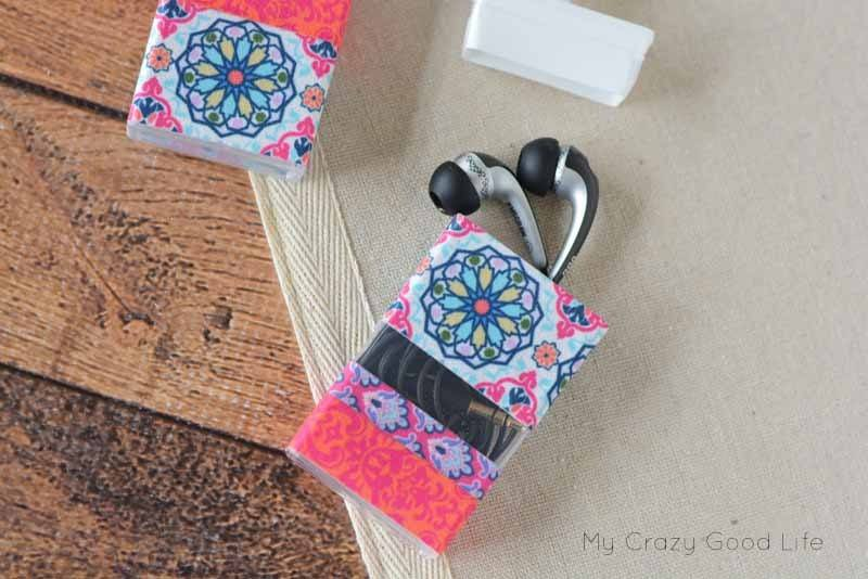 This quick and easy DIY Earbud Holder is a perfect way to store your earbuds. As a bonus, it's super easy to see at the bottom of your backpack or purse!