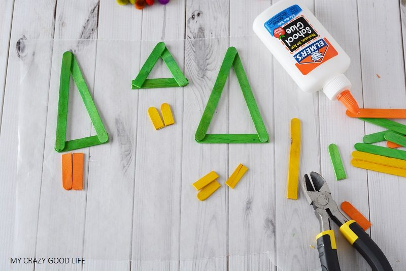 "The holidays are typically when we have some ""down time"". This easy craft is great, make these popsicle ornaments with the kids or the whole family!"