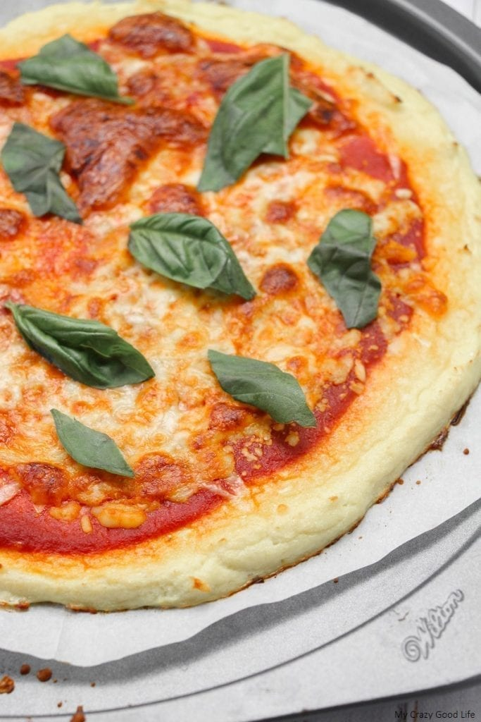 This low carb cauliflower pizza crust is a family favorite! It uses only 3 ingredients and is so easy to make on pizza night!