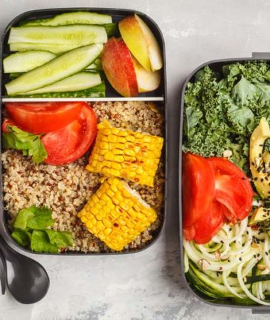 two meal prep containers with utensils