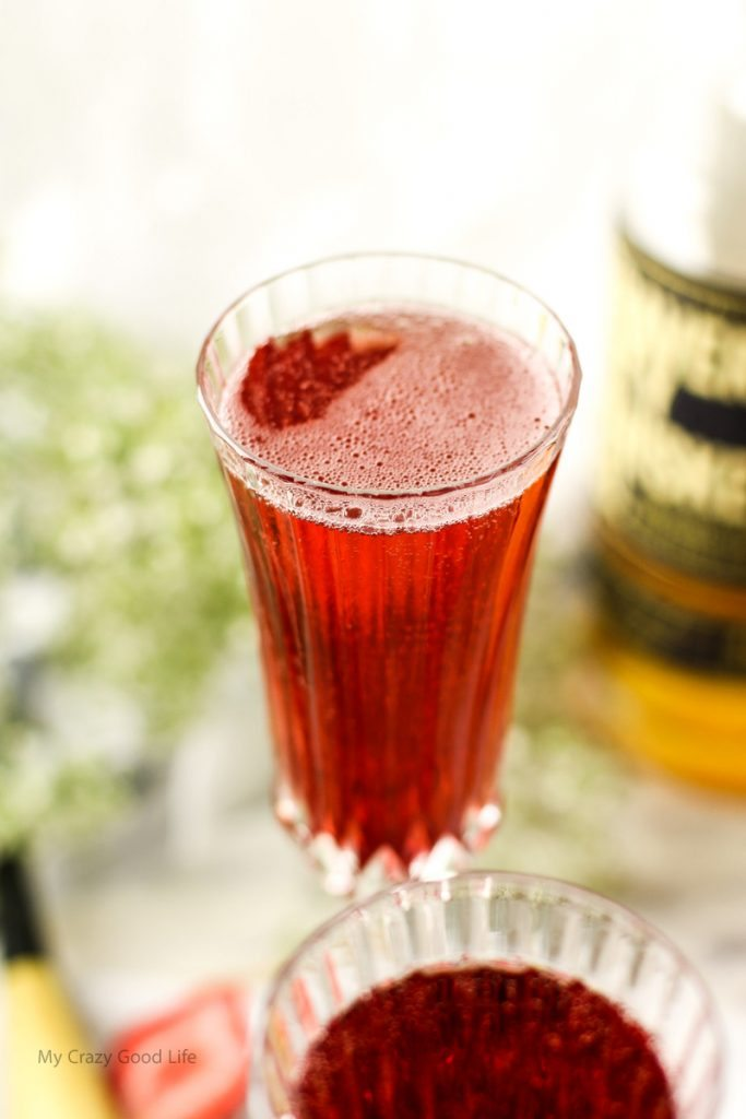 This Strawberry Whiskey Champagne Cocktail will impress your friends! Champagne cocktails are perfect happy hour drinks, as well as celebratory drinks!