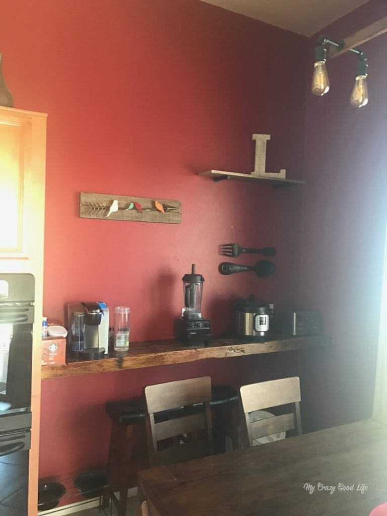 Our Before and After pictures of a home refresh project, which included new decor, a shiplap wall, and a ton of paint!