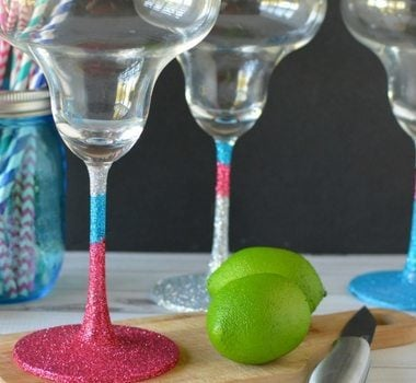Making DIY glitter margarita glasses is an easy, fun, and useful project. You can keep them for yourself or add them to a gift basket!