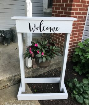 This DIY welcome sign is made with a Cricut and s a great weekend project. It's not too complicated and a DIY plant hanger makes a lovely addition to the front yard, porch, or give it as a gift!