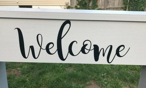 This Cricut welcome sign is a great weekend project. It's not too complicated and a DIY plant hanger makes a lovely addition to the front yard, porch, or give it as a gift!