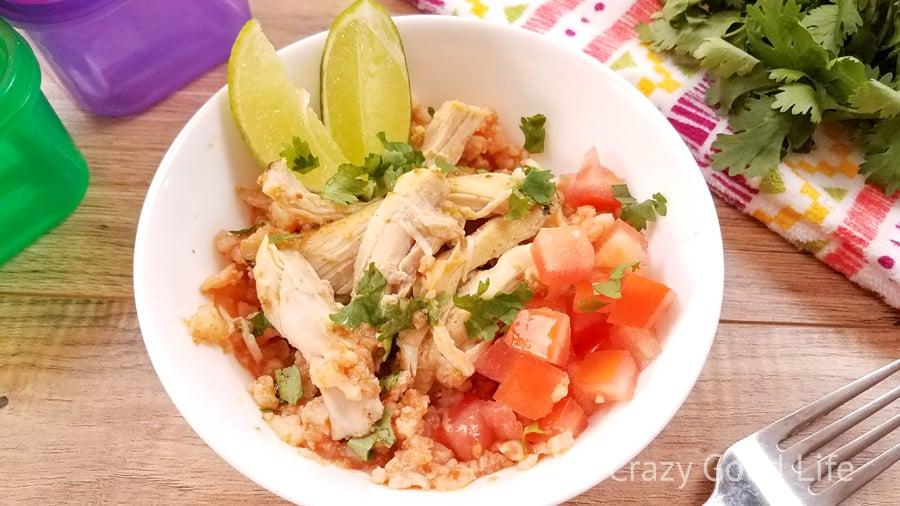 cauliflower rice with chicken in a white bowl