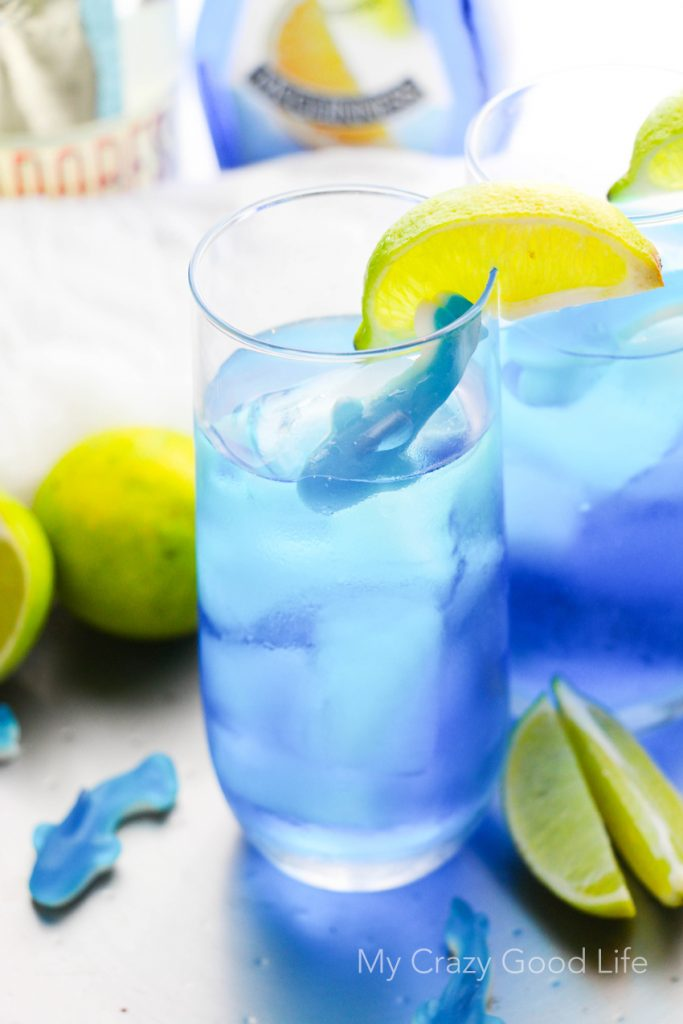 There's nothing better than curling up on the couch and enjoying Shark Week with a drink! This fun Shark Bite Margarita is the perfect Shark Week companion! Be careful... this one is strong, and it bites back!