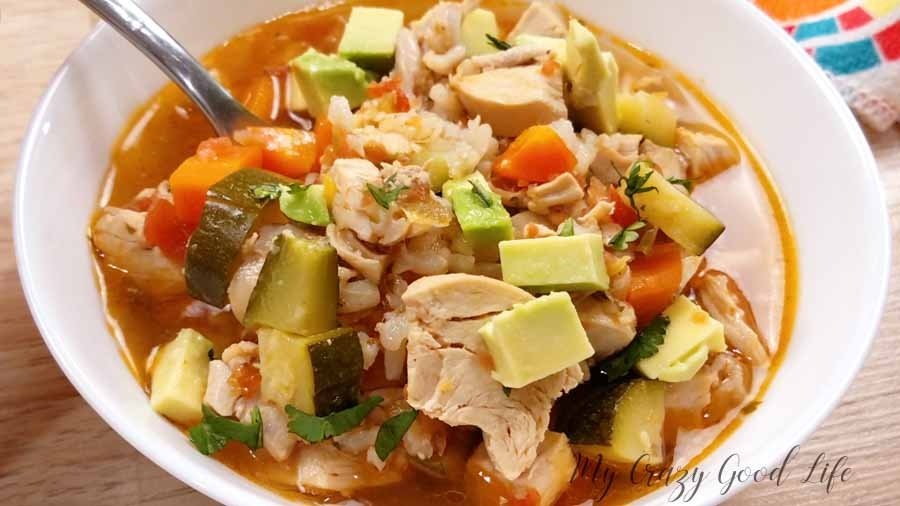 rotisserie chicken soup in a white dish.