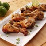 Cilantro Lime Chicken Drumsticks finished on a white long plate waiting for someone to devour them!