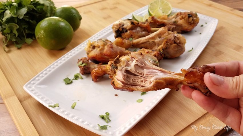 Cilantro Lime Chicken Drumstick with a bite out of it above the others that are finished cooking and ready for dinner. Delicious Weight Watchers Cilantro Lime Chicken in the Instant Pot