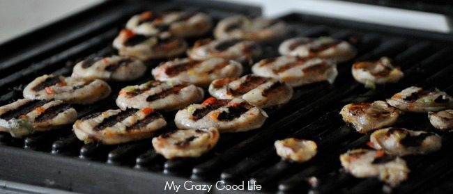 Sausage pieces are on the grill cooking perfectly in slices for the Healthy Weight Watchers Casserole.