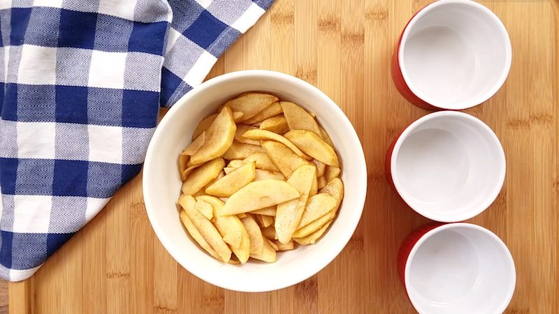 A large bowl of pumpkin spiced apples for a party or event.