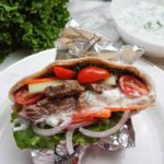 Finished beef gyros prepared and ready to dig in. Topped with fresh tomatoes, onion, lettuce, and sauce!