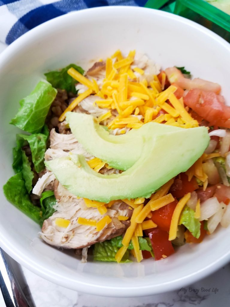 A great shot of this delicious WW burrito bowls recipe all finished up and topped with cheese, avocados, and tomatoes.