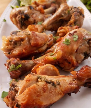 image of cooked drumsticks on white plate