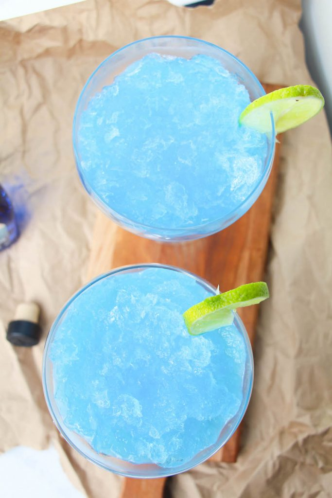Top only view of these two frozen blue margaritas.