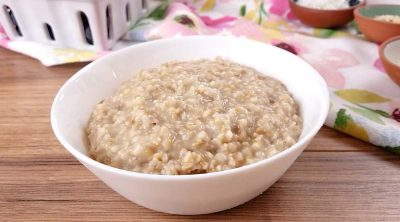 plain cooked steel cut oats in a white bowl