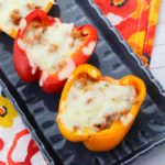Slow cooker pizza stuffed peppers are a tasty twist on this classic dish. You can make this delicious recipe for lunch, dinner, or as a quick and easy meal prep for the week ahead! #slowcooker #21dayfix #recipes