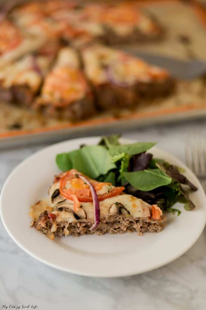 Who among us can deny the draw of a delicious slice of pizza? Not me! I love pizza and this meatza recipe is a low carb, 21 Day Fix option. #lowcarb #meatza #keto #glutenfree #21dayfix