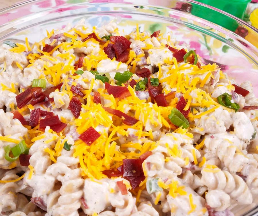 close up of instant pot crack chicken pasta salad in a clear glass bowl