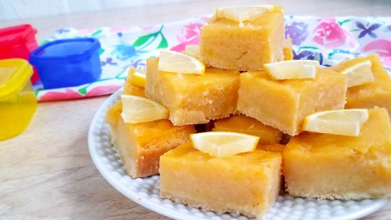 lemon bars on a white plate