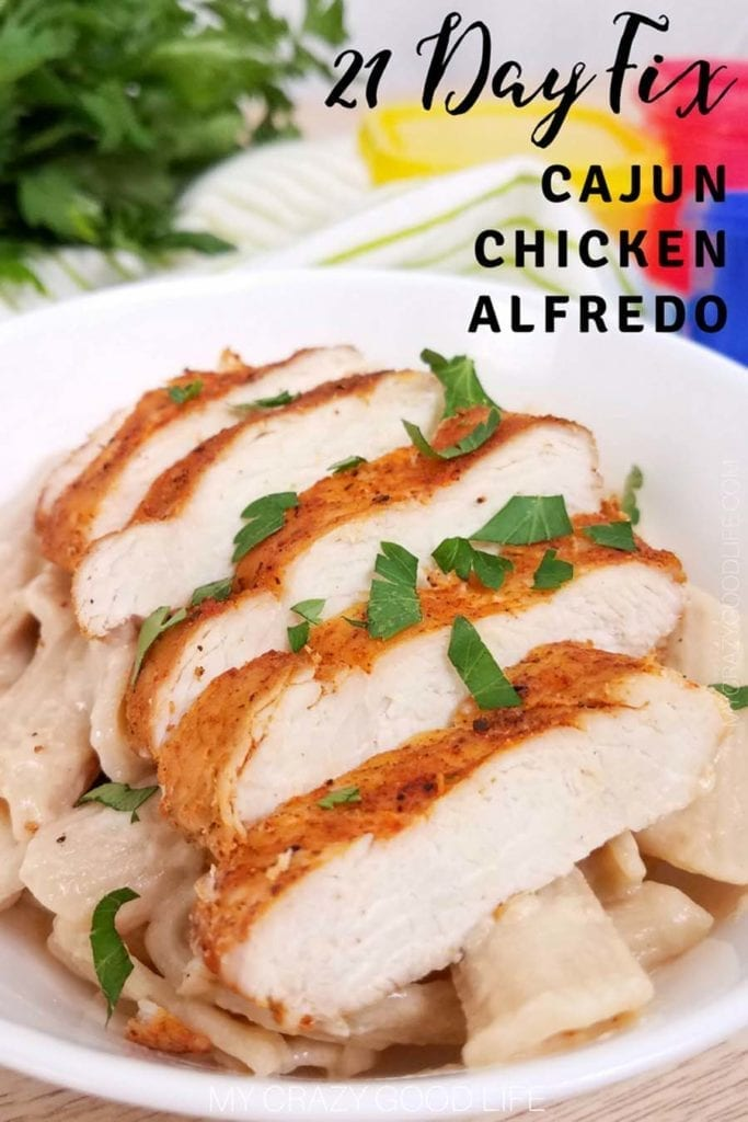 This cajun chicken alfredo is a healthy dinner recipe the whole family will love. It's a spicy take on your favorite chicken alfredo recipe! This healthy alfredo sauce recipe is super versatile so you'll want to keep it on hand for all your pasta dishes! #21dayfix #2bmindset #healthyrecipes #chickenalfredo #dinnerrecipes