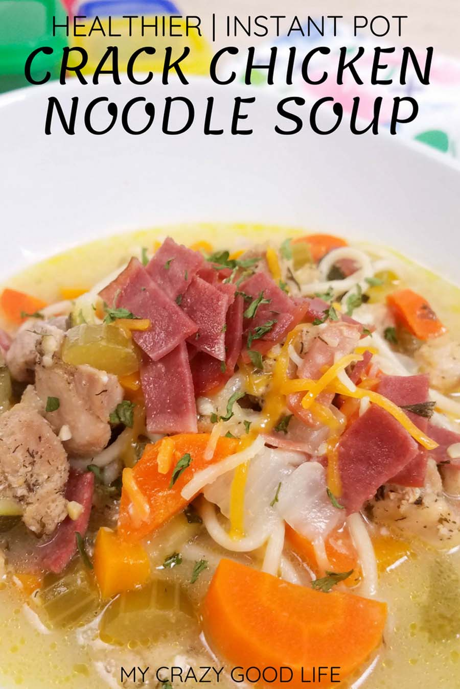 If you love Crack Chicken, you're going to love this homemade Crack Chicken Noodle Soup Recipe! The mix of cheese, bacon, and ranch in this comforting homemade soup is perfect on a chilly day. This is healthy Crack Chicken Soup, so you won't feel bad about saving the leftovers to eat all week! Cracked Out Chicken | Instant Pot Crack Chicken Soup | Slow Cooker Crack Chicken Soup | Healthy Soup Recipe #21dayfix #healthy #weightloss #weightlossrecipes #2bmindset #beachbody #healthysoup