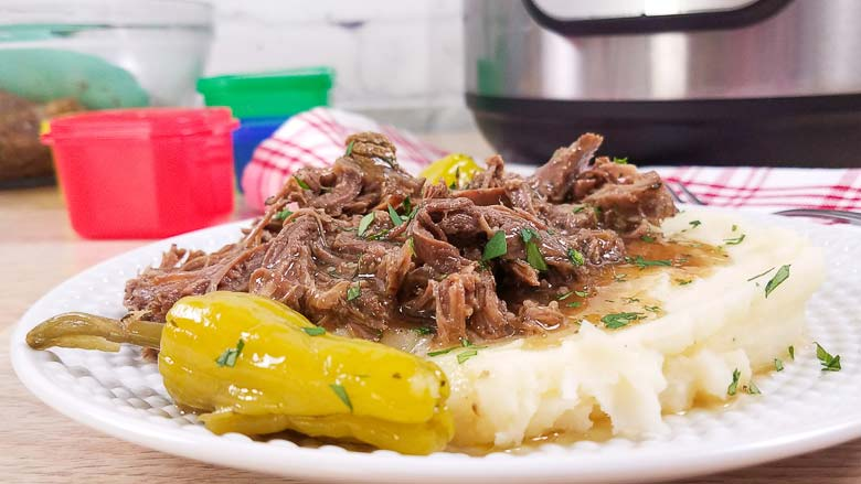 mississippi pot roast and mashed potatoes on white plate
