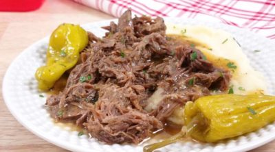 mississippi pot roast with pepperoncinis on a white plate