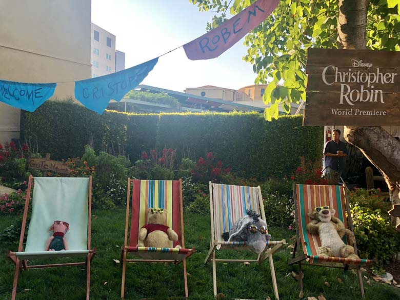 Winnie the Pooh characters sunbathing on the red carpet