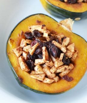 baked sweet acorn squash on a white plate