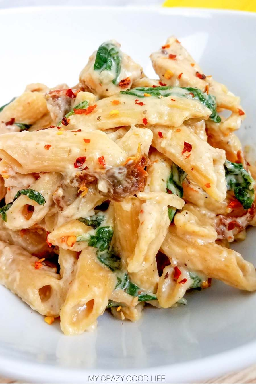 close up image of pasta on white dish