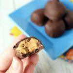 These gluten free Buckeyes are a protein-packed way to satisfy a peanut butter cup craving! Just four ingredients to a delicious and easy healthy dessert–including honey and coconut flour! Use dark chocolate chips for a healthier coating. 21 Day Fix Dessert | 2B Mindset Dessert | Healthy Desserts | Healthy Peanut Butter Cup | keto Buckeyes
