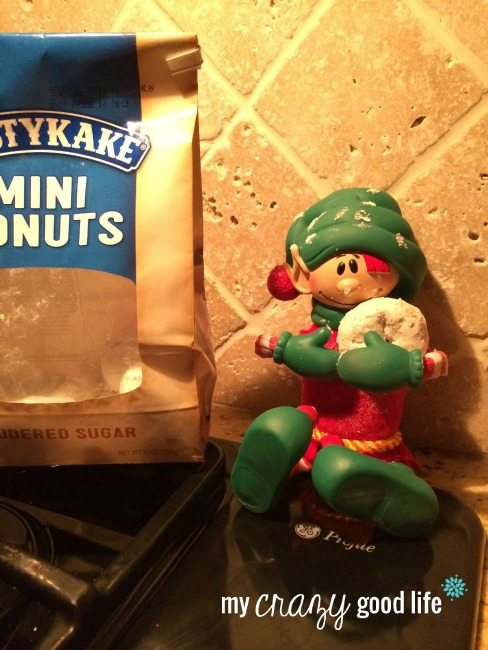 elf on the shelf eating powder donuts