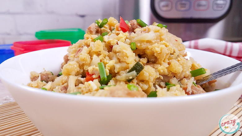 close up of cauliflower fried rice in a white bowl