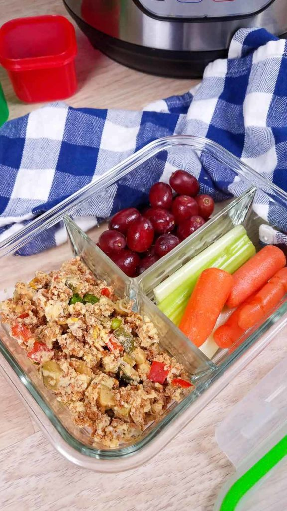 turkey chorizo breakfast casserole in meal prep container with fruit and vegetables