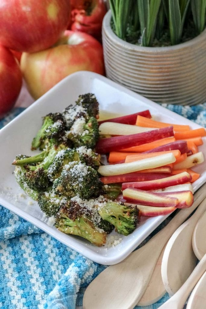 image of air fried broccoli with parmesan and colored carrots on white plate