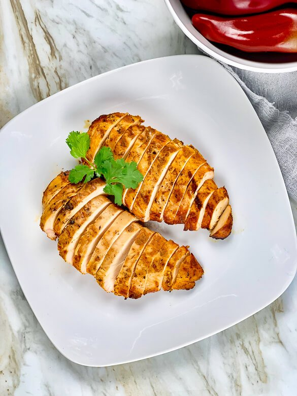 grilled and sliced chicken on a white plate