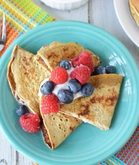 image of healthy crepes with fruit and greek yogurt on a turquoise plate