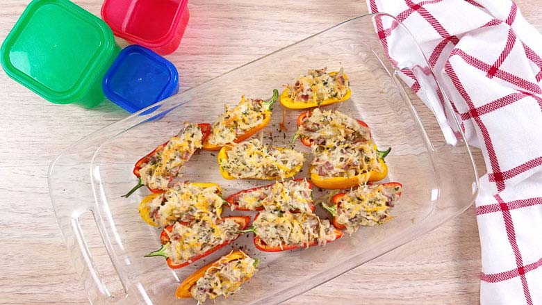 glass baking dish with mini peppers filled with crack chicken dip