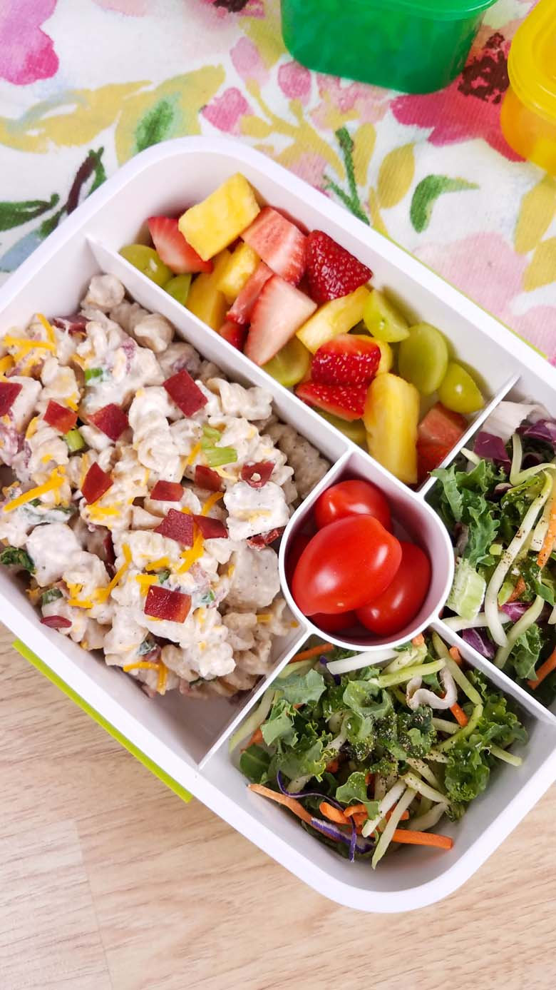 crack chicken casserole and fruit in a to go container